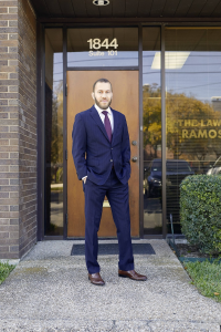 Eric Ramos (standing in front of office)