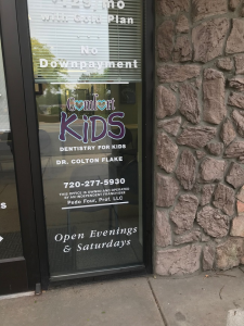 Signage on glass pane on Aurora pediatric dentist