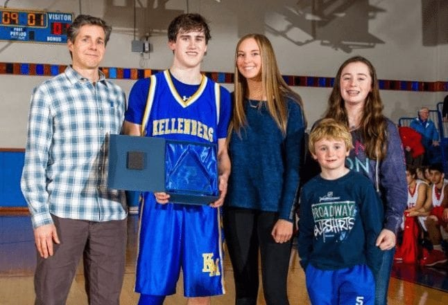 Kyle DeVerna recieves the awared for Most Valuable Player of the game. Pictured here with the family of Tom Crotty following Kellenberg's victory. (Credit: Steven Ryan)
