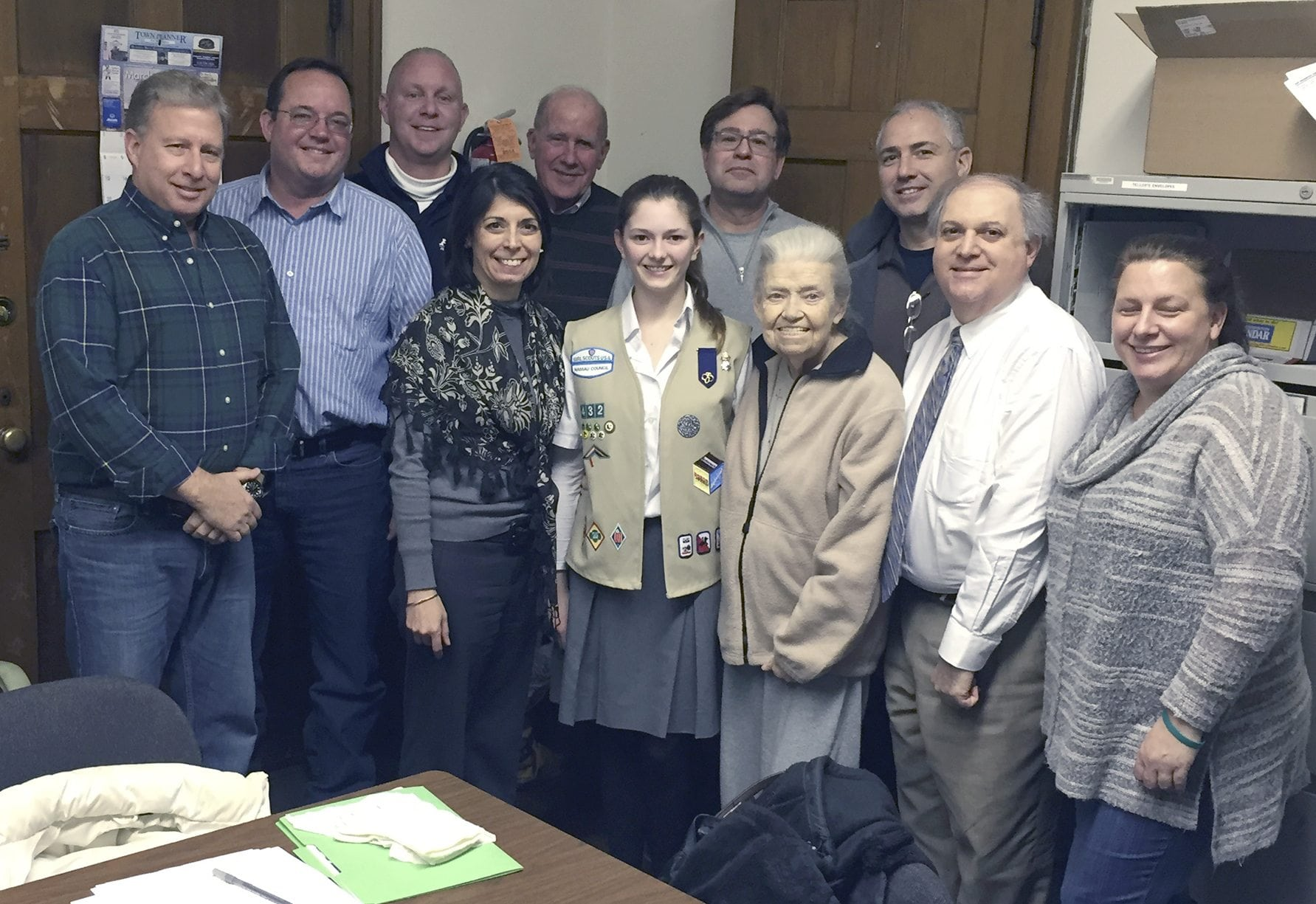 Olivia Moss with members of the Greater Port Washington Business Improvement District (Credit: Port Washington News)