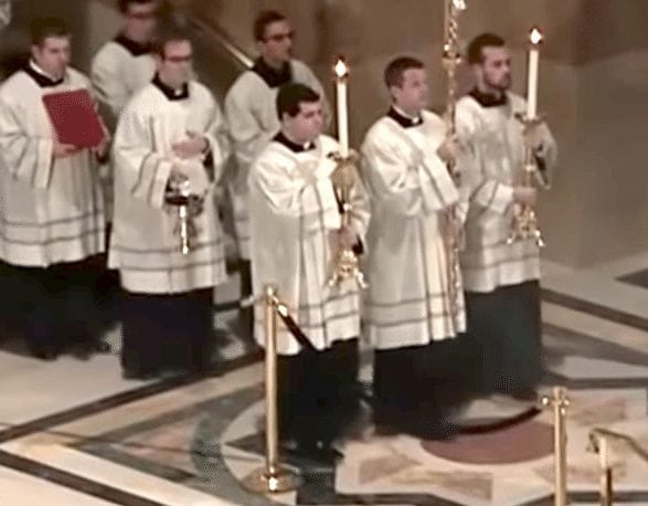 Matt Browne '11 serving as acolyte to the right of the cross-bearer.