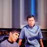 Spock and McCoy sit next to each other