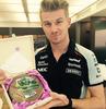 Nico H holding a cake
