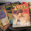 Pictured- Image of vintage romance magazines from the 30s or 40s.