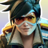 Tracer from Overwatch on a yellow/purple gradient background, giving a determined grin.