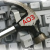 "A hammer with the letters ""AO3"" on top of a keyboard with keys knocked loose."