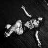 black and white icon of a girl lying on the floor, arms spread and legs folded