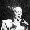 The Bride of Frankenstein applying makeup