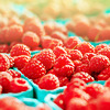 stock photo of several baskets of raspberries