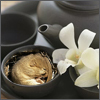 a black tea service, a dormouse asleep in the cup