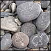 rounded pebbles with lovehearts chalked on them