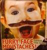 furry face - picture of a young girl with a fake moustache afixed under the nose