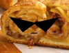 actual picture of a strudel wearing pointy shades and a frown