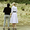 two white women with their backs to the camera.