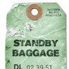 "a luggage tag saying the word ""baggage"""