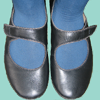 Feet in blue tights and black mary janes