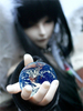 a girl hold the world in a outstretched arm toward you.