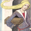 Medieval woman in a long dress carrying a box