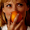 Parker from Leverage smiling behind an orange
