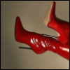 Kinky red boots. Icon by xelaz_iconz on LJ.