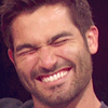 Hoechlin wrinkles his nose when he laughs