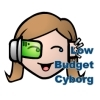 "cartoony face with cyborg eye implant and the text ""Low Budget Cyborg"""