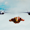 no text just tony stark flying in the iron man suit with two fighter jets behind him