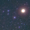 A field of stars, one of which is significantly brighter and larger than the rest.