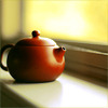 a teapot on a windowledge