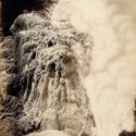 Whatapoho (geyser) with incrusted rock, Rotomahana.