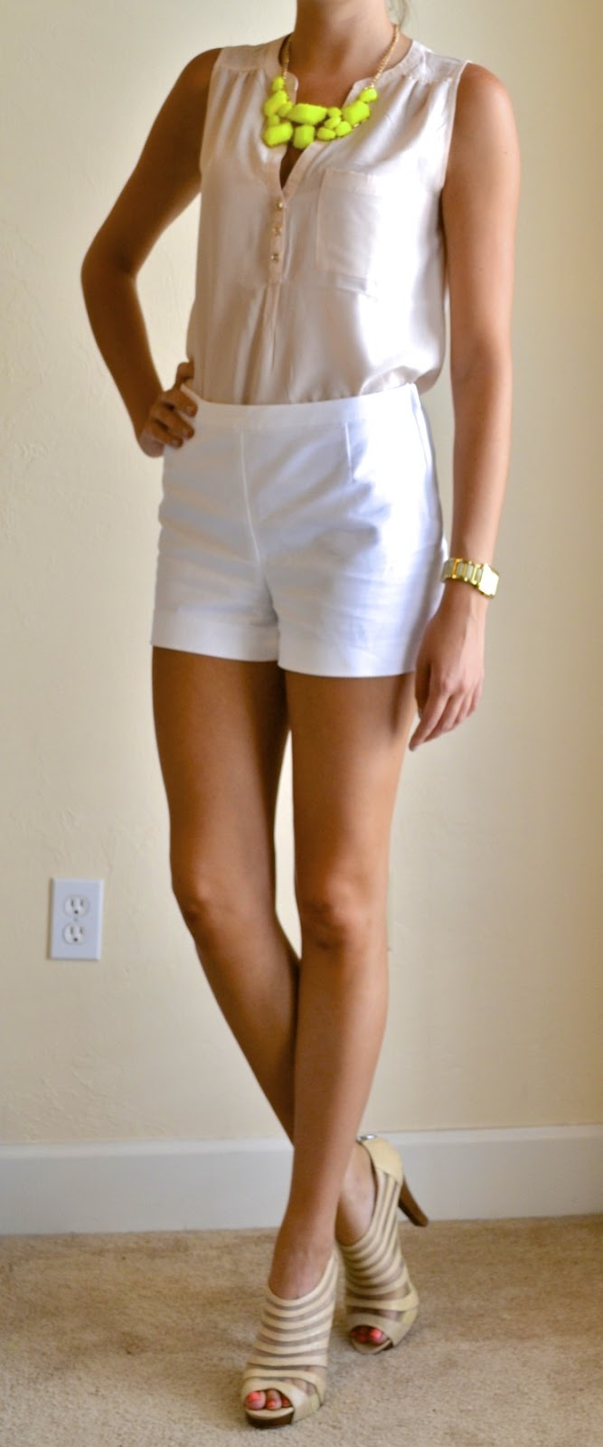 outfit post  white shorts  nude button up  neon necklace