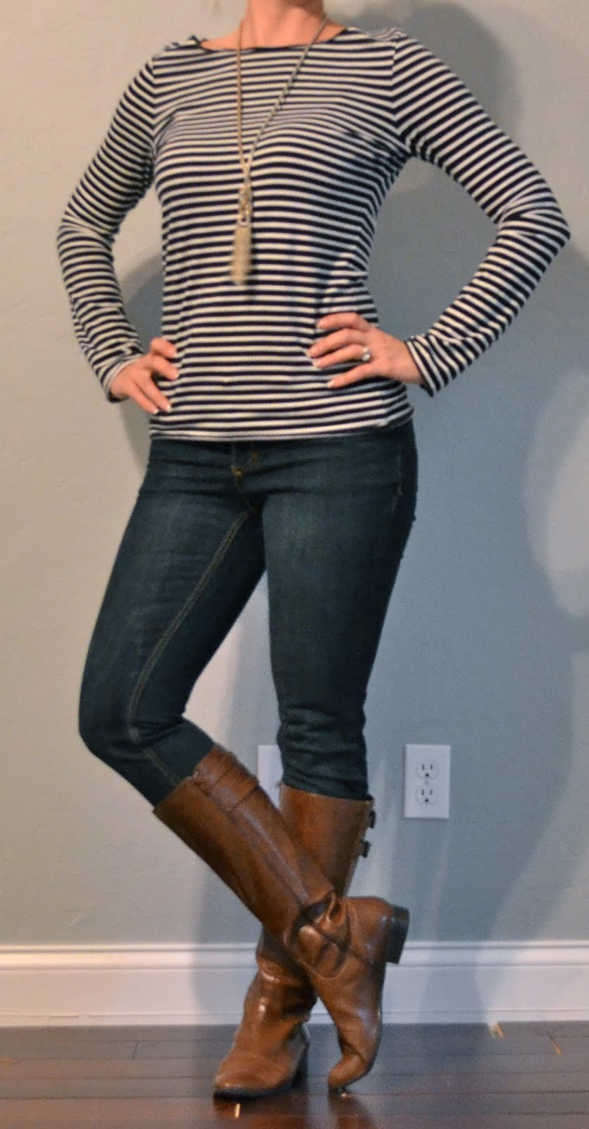 Outfit post striped long sleeved shirt skinny jeans brown boots