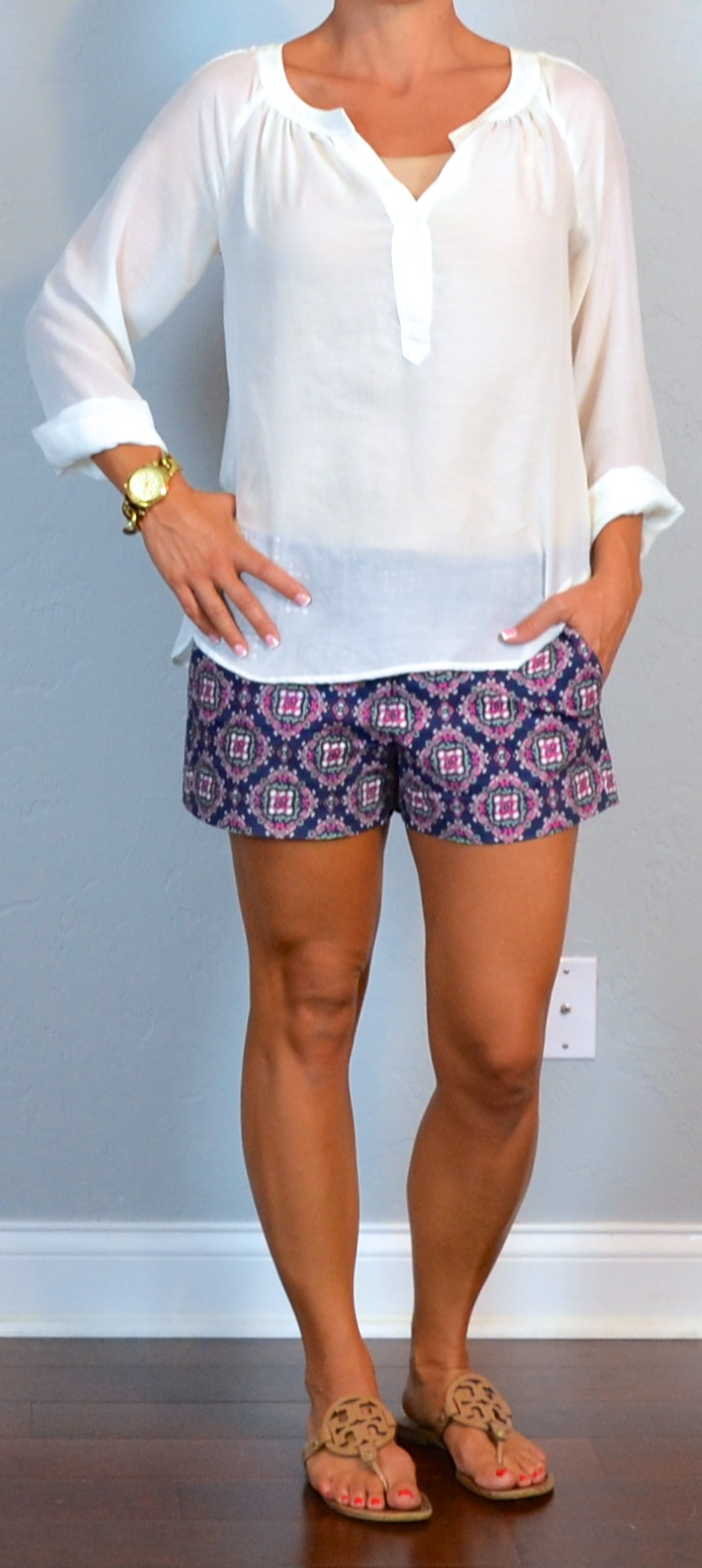 outfit post  paisley shorts  white cotton peasent blouse  medallion sandals