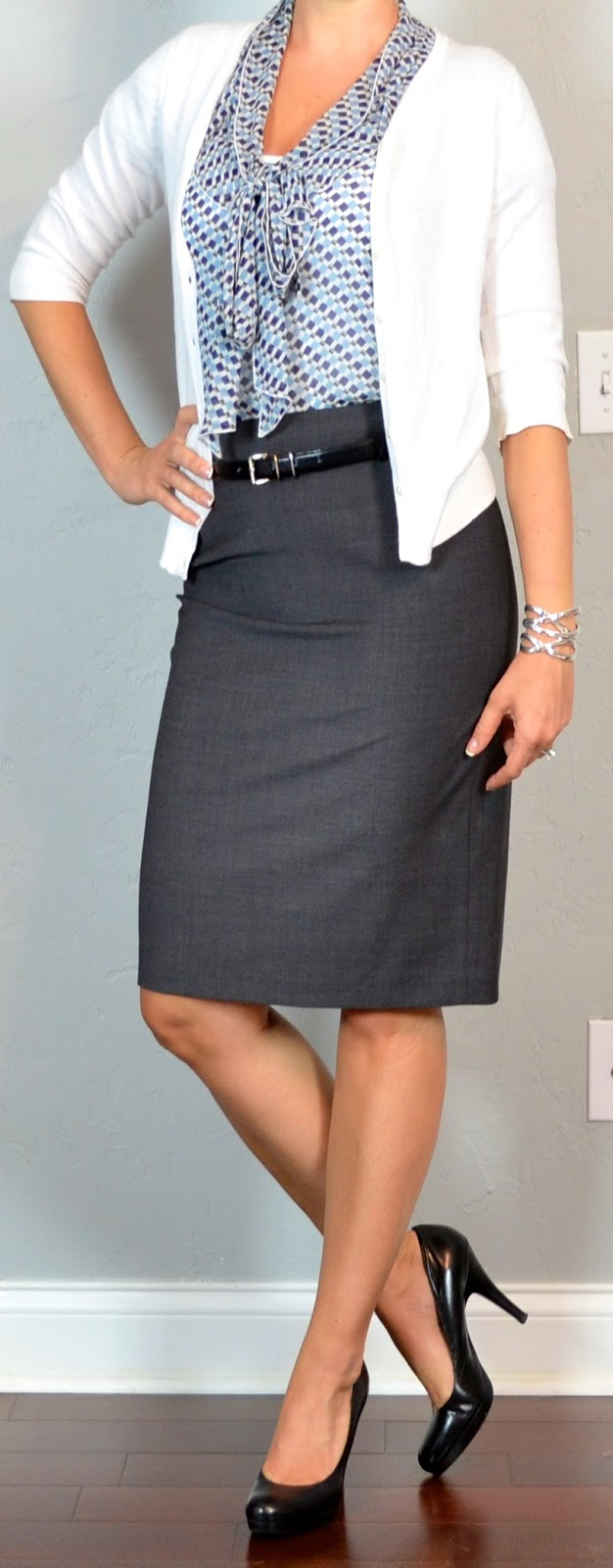 Outfit Post Grey Pencil Skirt Blue Pattern Tie-neck Blouse White Cardigan Black Pumps