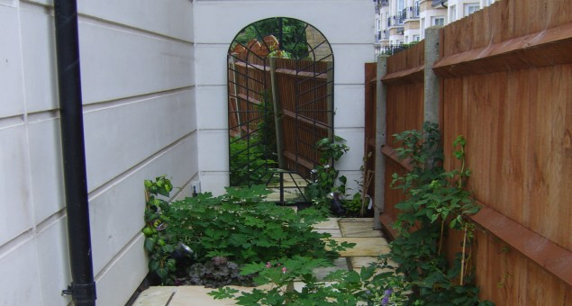 The neglected side return was given some interest by adding a perspective mirrored arch and softened with planting.