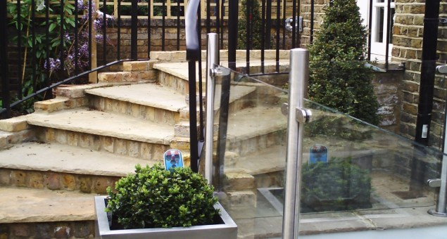The lower set of steps was made safe with balustrades. The flight leading up to the study was also improved, by introducing a curve to allow for more, and shallower steps with a traditionally styled metal handrail.