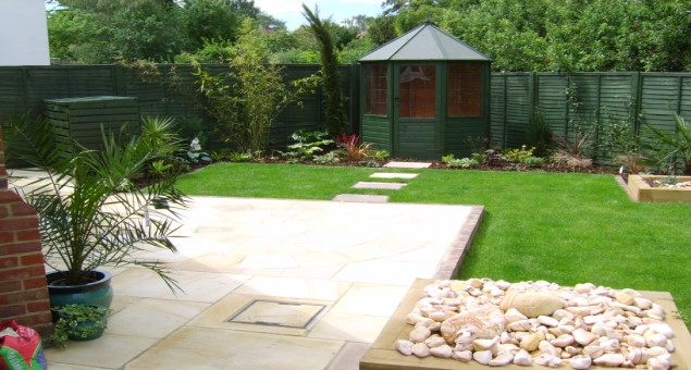 Next to the house we constructed two natural sandstone patios, either of which could then be used for a table and chairs giving flexibility to the design.