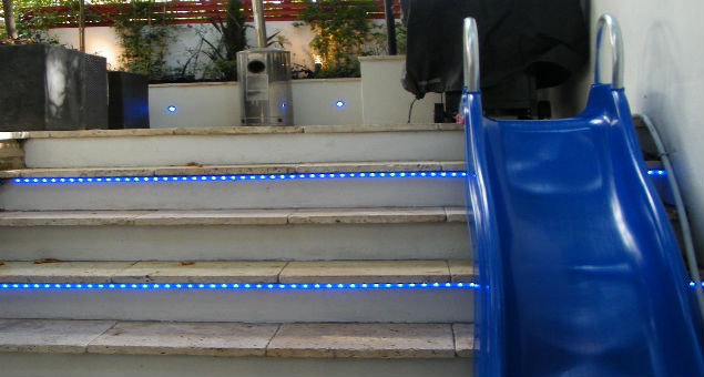 There is even a slide, cleverly fitted to the side of the steps which are lit with rope lights at night.