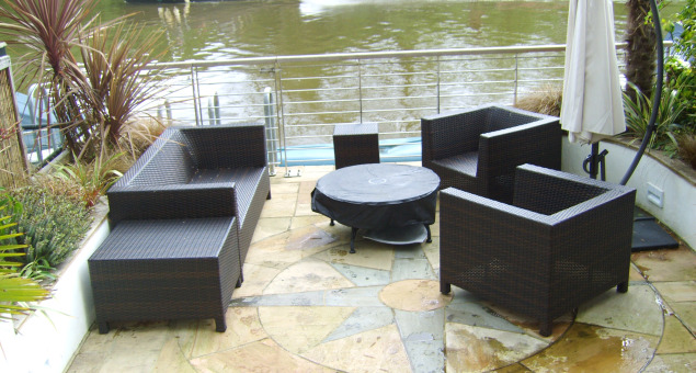 The small site consisted of some very uneven paving on two levels making it virtually unusable for entertaining as there was insufficient space for a table and chairs. Our clients brief was both to rectify this problem and to introduce a nautical theme, to include a 'ship's rail' as a barrier to the drop to the river.