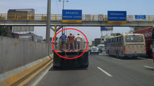 Vía de Evitamiento: hombres viajan en la tolva de tráiler