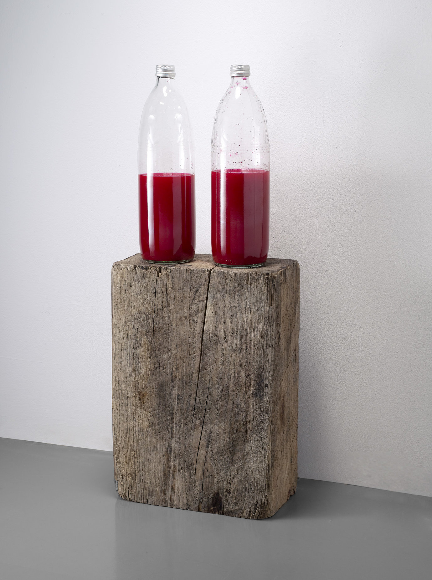 ", 2007. Wood block, glass bottles with metal screw lids, ink, water, 25-1/2"" x 10"" x 5"" (64.8 cm x 25.4 cm x 12.7 cm)."