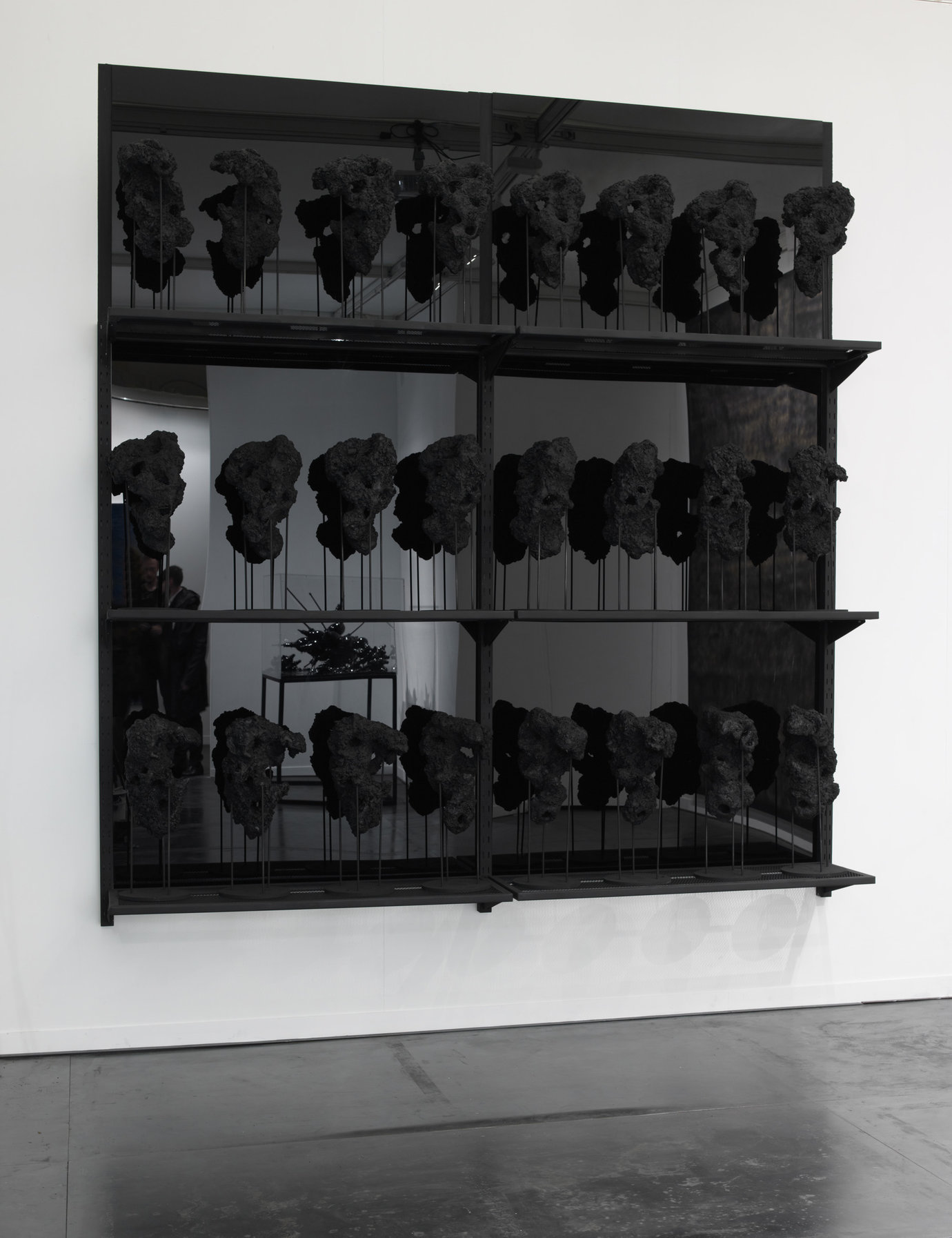 , 2011. black wax, carbon, molded rocks, resin, steel pedestals.