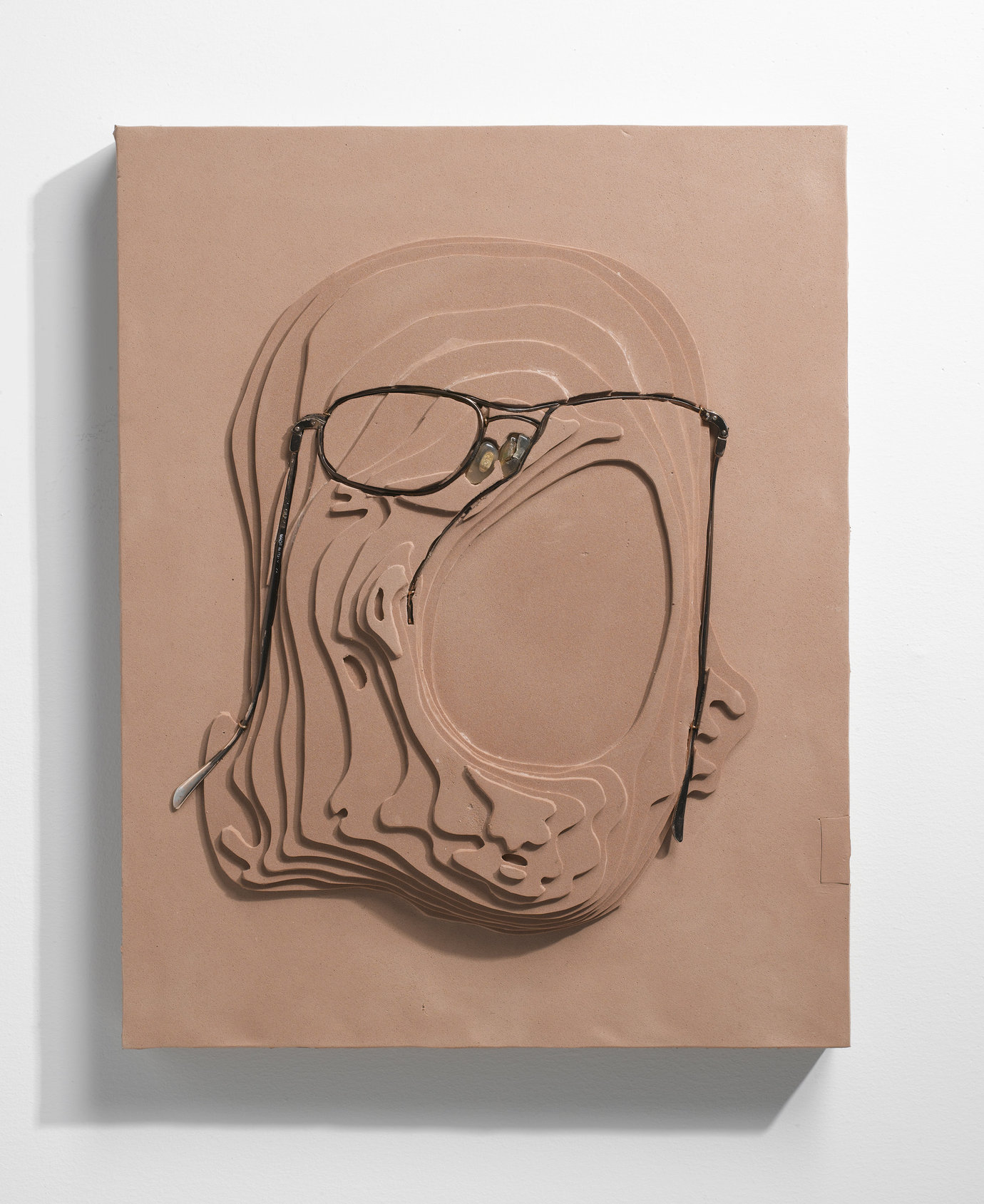 ", 2009. foam and eyeglasses on panel, 12"" x 9-1/2"" x 1-3/4"" (30.5 cm x 24.1 cm x 4.4 cm)."