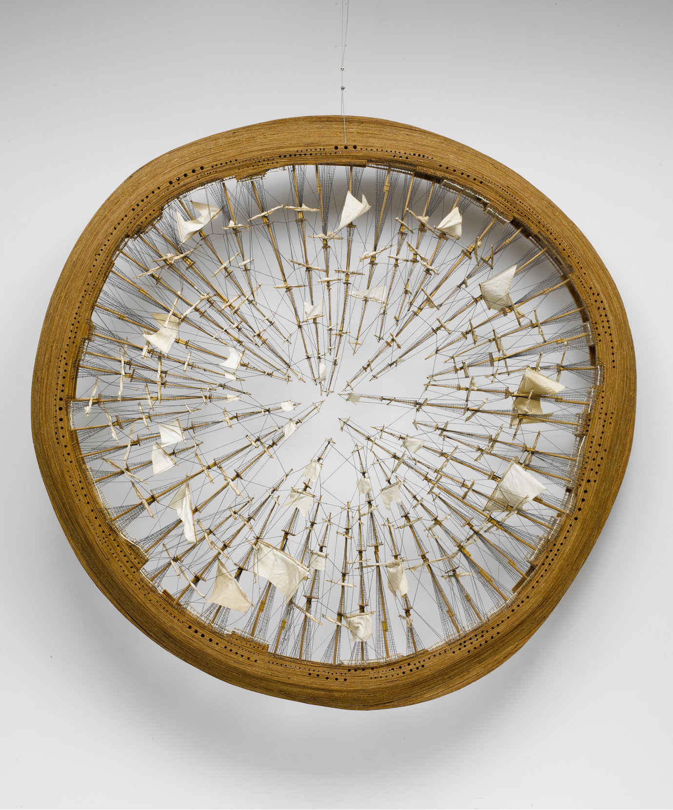 ", 1995. Fabric, string, and wood, 90"" (228.6 cm) diameter x 10"" (25.4 cm)."