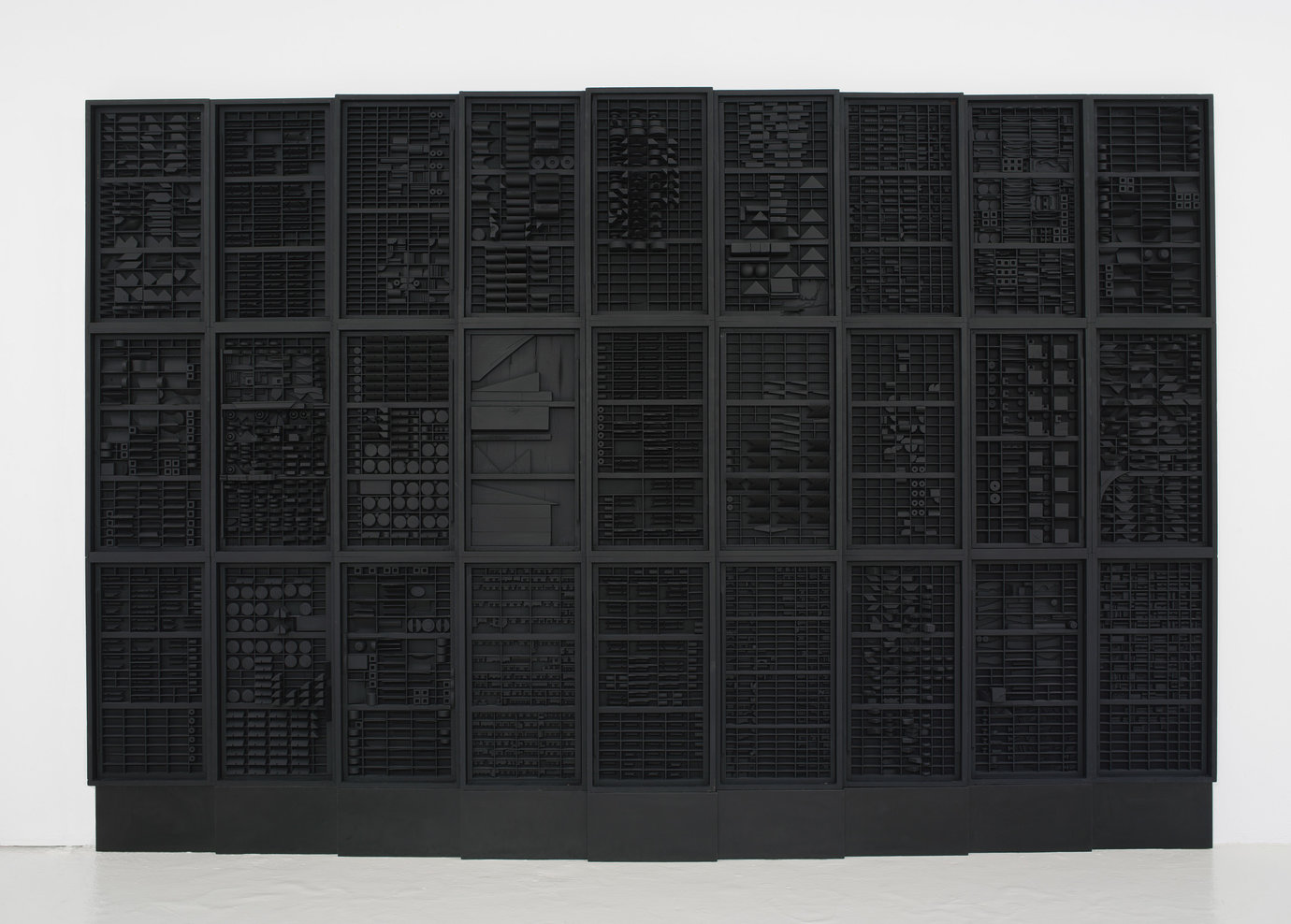 ", 1973. wood painted black, 8' 5-1/4"" x 13' 10"" x 6"" (257.2 cm x 421.6 cm x 15.2 cm), 9 elements plus 2 part base, 11 parts total."
