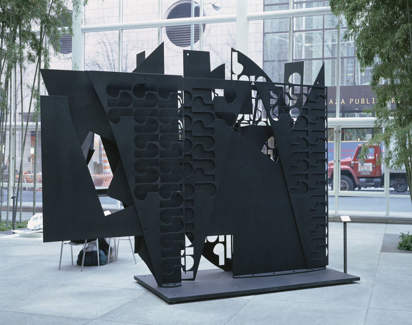 ", 1976-80. Cor-ten steel painted black, 11' 6"" x 14' 4"" x 5' (3.505 m x 4.369 m x 1.524 m)."
