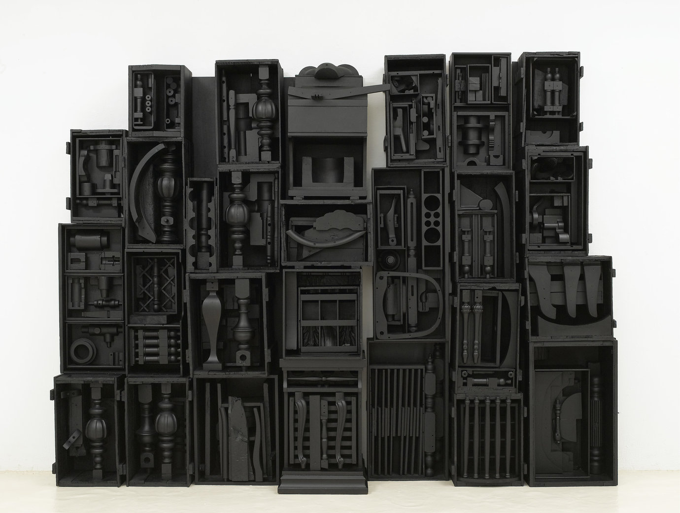 ", 1964. Wood painted black, 8' 4"" x 10' 11-1/2"" x 1' 6-3/4"" (254 cm x 334 cm x 47.6 cm), 16 elements plus 2 part base, 18 parts total."