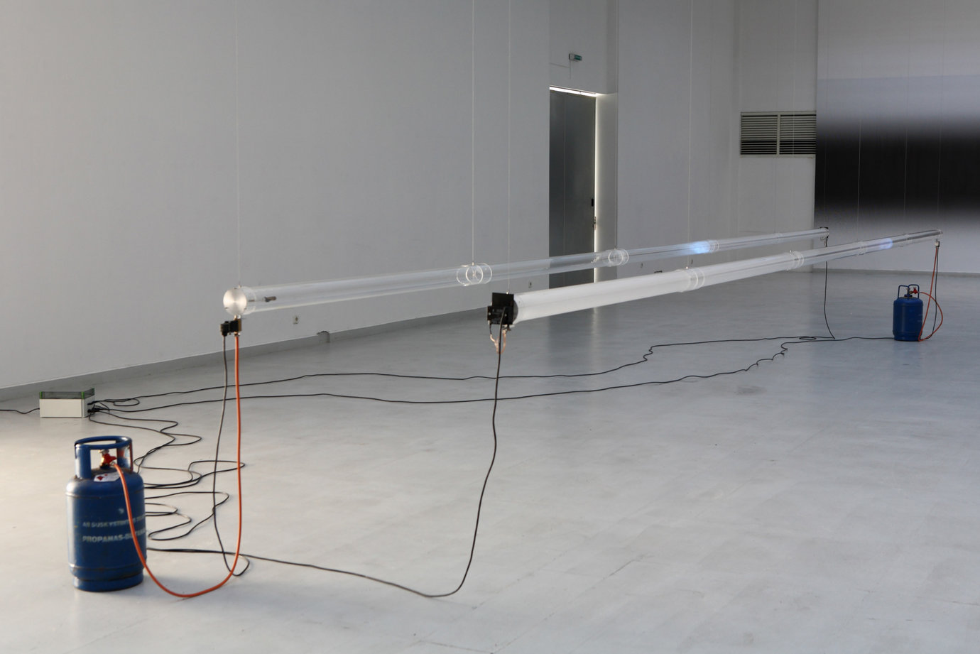 , 2007. perspex tubes, gas, igniting mechanism, installation dimensions variable, site specific.