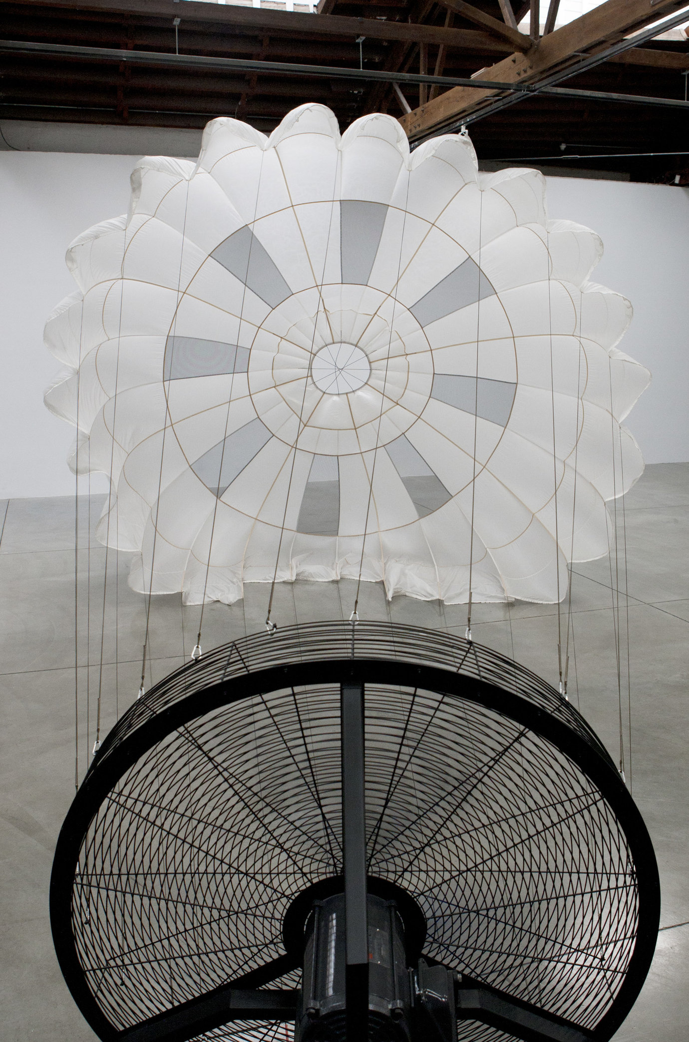 , 2011. Parachute, wind machine, sound proof paneling, installation dimensions variable, site specific.