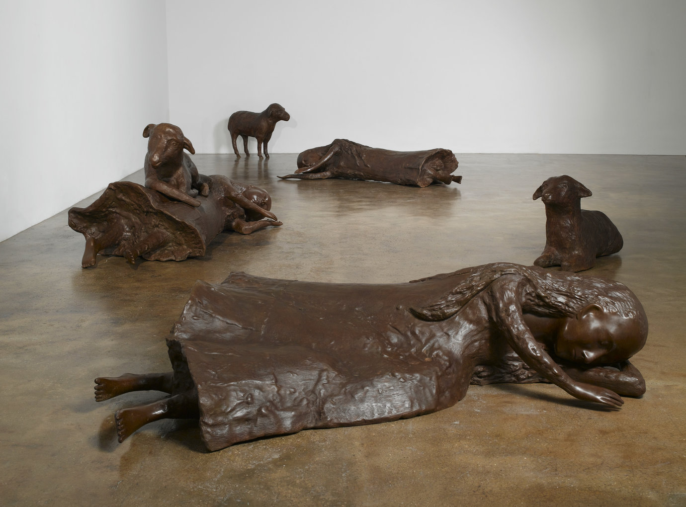 ", 2009. Bronze, overall installation dimensions variable&#x000A;30-1/2"" x 13"" x 42"" (77.5 cm x 33 cm x 106.7 cm), standing sheep&#x000A;22-1/2"" x 40"" x 15"" (57.2 cm x 101.6 cm x 38.1 cm), resting sheep&#x000A;34"" x 82"" x 39"" (86.4 cm x 208.3 cm x 99.1 cm), woman with sheep&#x000A;17-3/4"" x 84"" ."